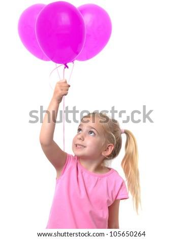 little girl holding three pink balloons - stock photo