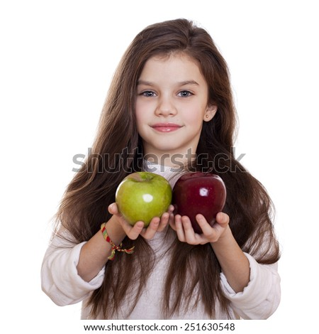 Little girl holding two apples, isolated on white background - stock photo