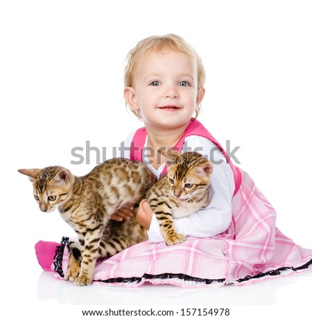 little girl holding two cats. isolated on white background - stock photo