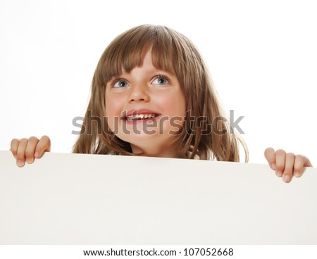 little girl holding  white board with empty space