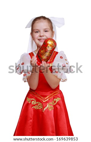 little girl holding wooden doll in tradition style Hohloma
