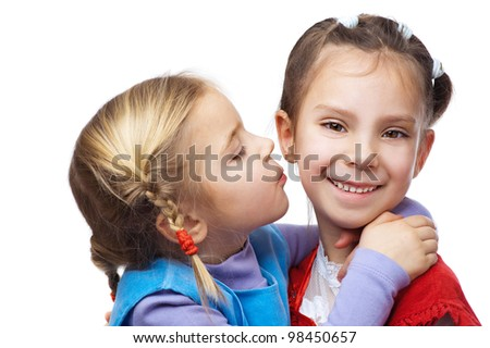 Little girl hugged her sister, isolated on white background.