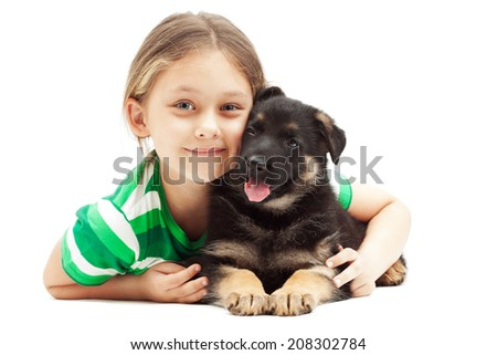 little girl hugging a German Shepherd puppy on white background - stock photo
