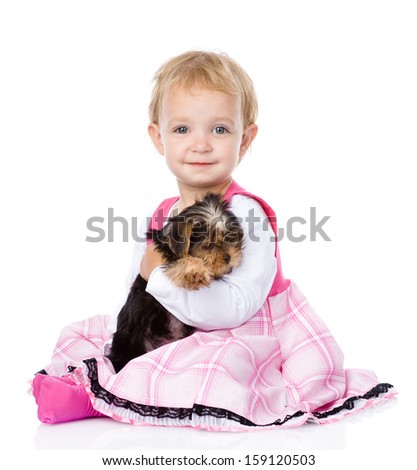 little girl hugging a puppy. isolated on white background