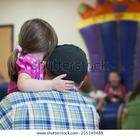 Little girl hugging her Dad - stock photo