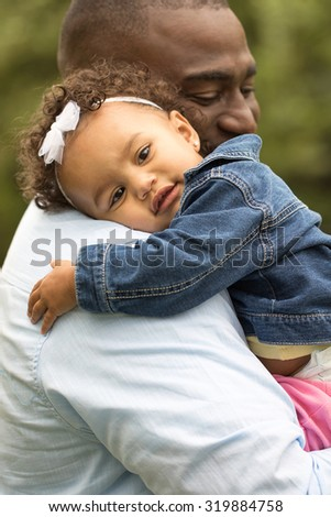 Little girl hugging her father. - stock photo