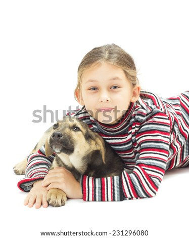 little girl hugging her four-footed friend on a white background isolated