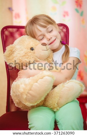Little girl hugging Teddy bear - stock photo