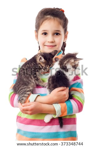 Little girl hugging two adorable kitten, isolated on white - stock photo