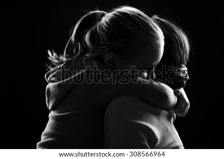 Little girl hugs her mother - stock photo