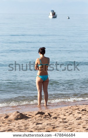 little girl in a bathing suit on the beach