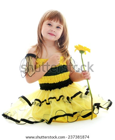 Little girl in a beautiful yellow dress isolated on white background.Happy childhood, adolescence, the development of the family concept. - stock photo