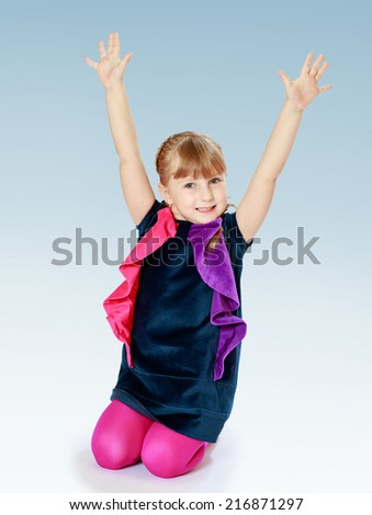 Little girl in a blue sundress raised her hands up ..Concept of childhood and family values.
