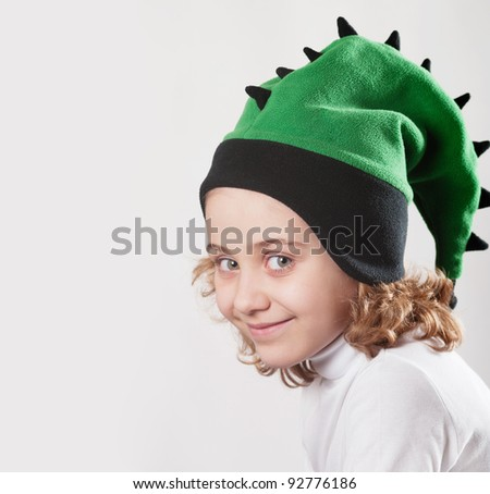 little girl in a cap depicting a dragon