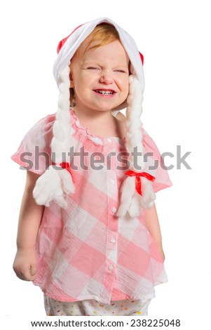 Little girl in a Christmas hat with braids. Isolated on white background. - stock photo