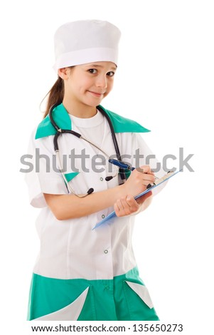 Little girl in a doctor costume, playing with stethoscope, isolated on white