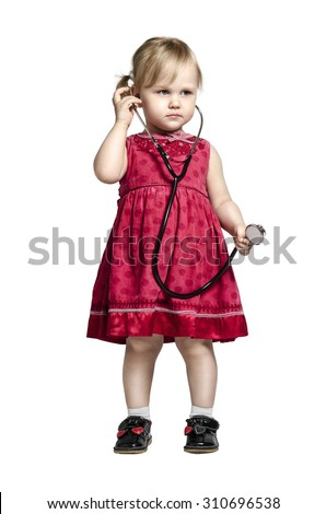 Little girl in a doctor costume with stethoscope in hand, isolated on white - stock photo