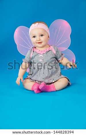 little girl in a dress and wings