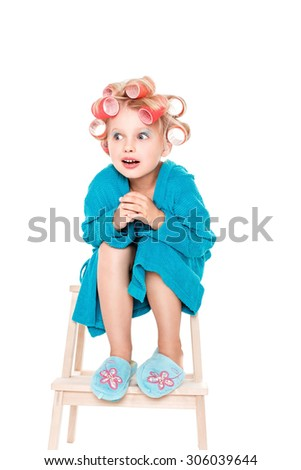 Little girl in a fashionable blonde bright clothes on an isolated white space for lettering - stock photo