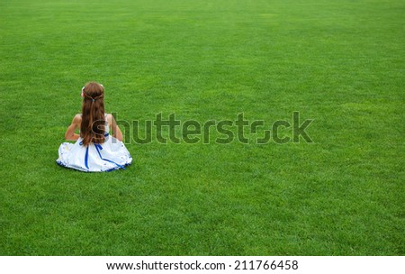 little girl in a  field - stock photo