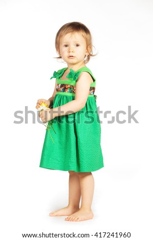 Little girl in a green dress - stock photo