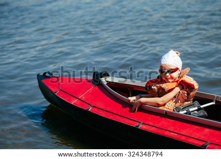 Little girl in a kayak. Family holiday.
