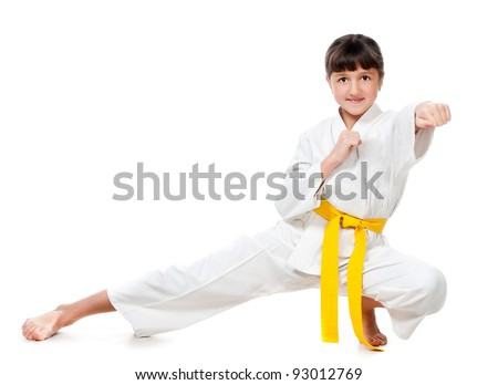little girl in a kimono with a yellow sash on a white background