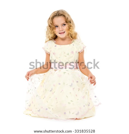 Little Girl in a Light Dress Posing, on white background