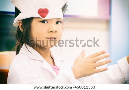 Little Girl in a medical Doctor clothing.