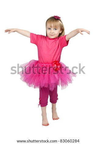 little girl in a pink dress dancing in studio isolated on a white background