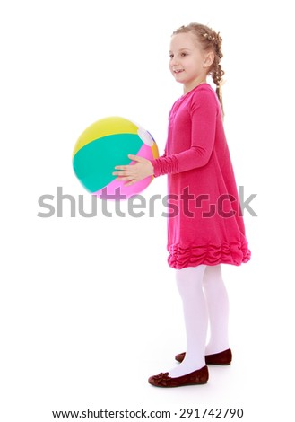 little girl in a pink dress with ball in hand - isolated on white background - stock photo