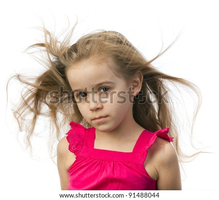 Little girl in a pink dress with fluttering in the wind hair on a white background - stock photo