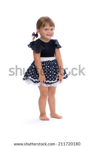 Little girl in a polka dot dress in studio isolated on white background. - stock photo