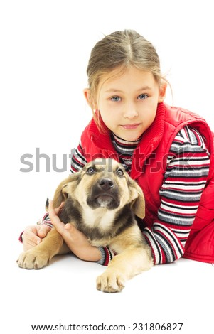little girl in a red vest hugs his dog on a white background isolated