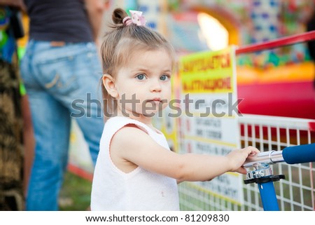 little girl in a supermarket - stock photo