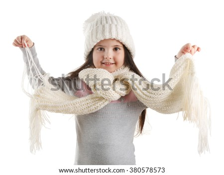 Little girl in a trendy knitted clothes, isolated on white