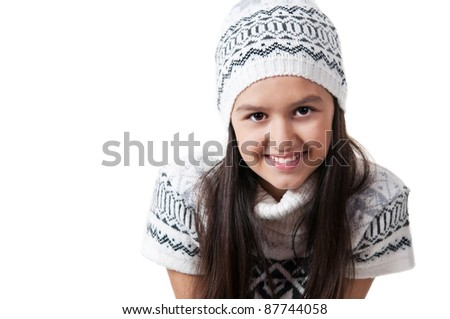 little girl in a winter jacket and hat isolated on a white background