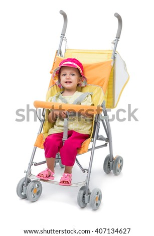 Little girl in a yellow baby carriage on a white background