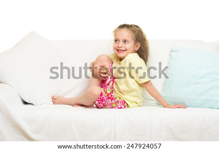 little girl in bed. white background