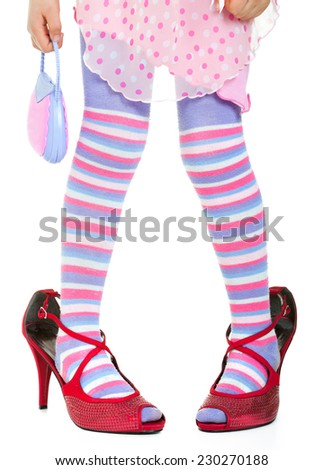 Little girl in big red shoes - stock photo