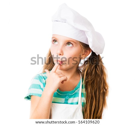little girl in chef hat licks a finger on a white background - stock photo