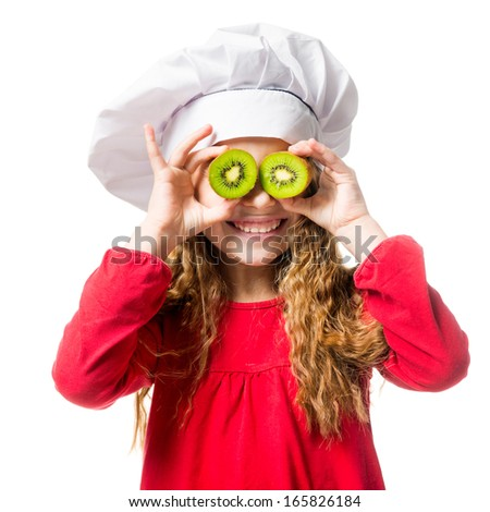 little girl in chef hat with dvemya rugs kiwi on eyes on white background - stock photo