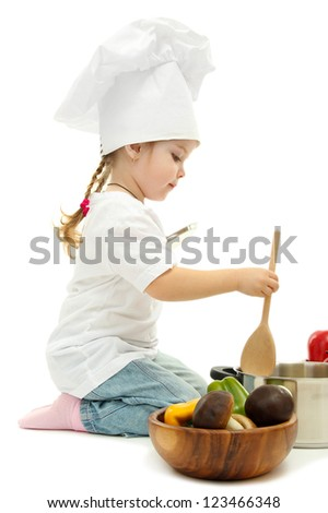 little girl in chef's hat with pan and vegetables, isolated on white - stock photo