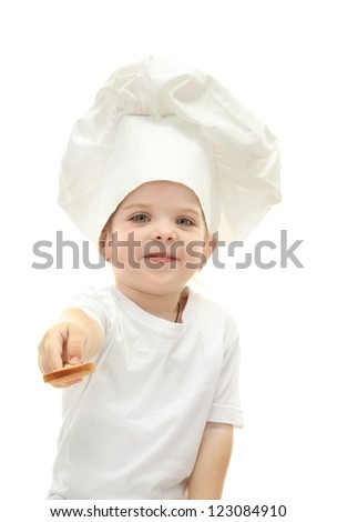 little girl in chef's hat with spoon, isolated on white