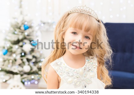 Little girl in christmas decorations - stock photo