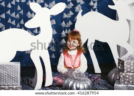 Little girl in christmas decorations. Decor winter forest. Little Princess - stock photo