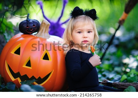 little girl in costume celebrate Halloween outdoor and have a fun. Tick or treat. - stock photo