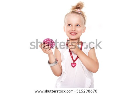 Little girl in fashionable clothes blond with a mirror and lipstick on a white space for writing