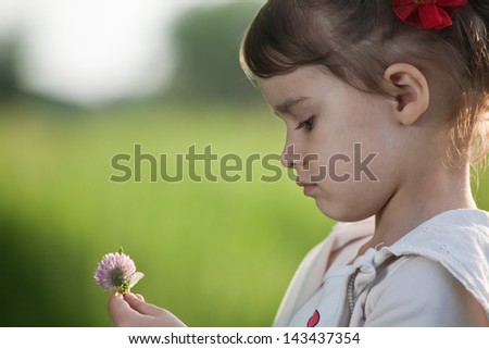 Little girl in flower field - stock photo