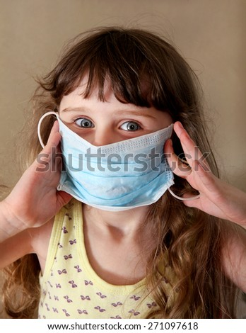 Little Girl in Flu Mask in the Room - stock photo